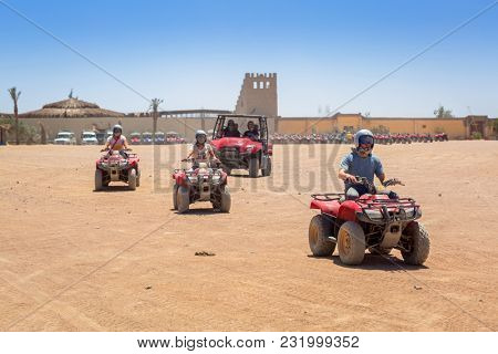 Hurghada, Egypt - April 16, 2013: Quad trip on the african desert near Hurghada, Egypt. Desert safari is one of the main local tourist attraction in Egypt.