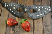 Erotic adult fetish BDSM mask and strawberry poster