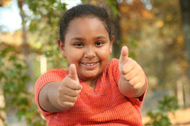 Thumbs Up From A Happy Little Girl.