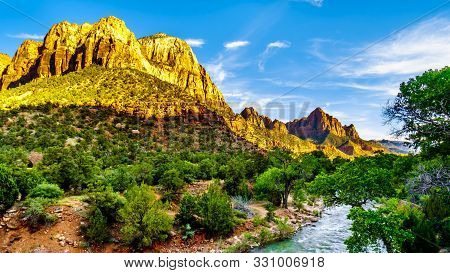 Sunset Over The Rugged Sandstone Of The Watchman And Bridge Mountains In Zion National Park In Utah,