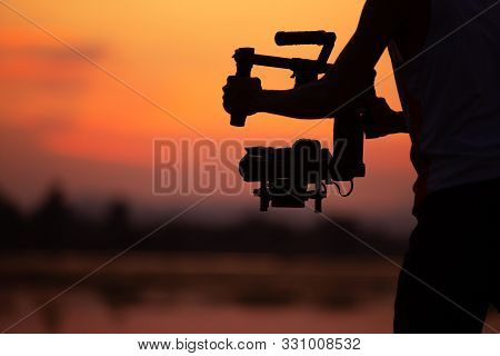 Cinematographer Stabilized Shooting At The Outdoor Working Of The Freelance Content Creator Or Produ