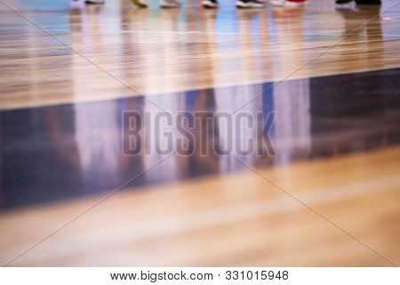 blurred background of basketball players on court during game - very shallow depht of field