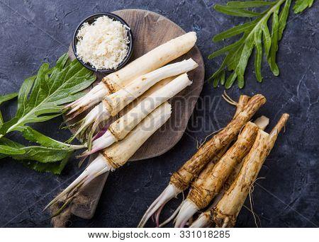 Horseradish. Fresh Orgaanic Horseradish Or Horse-radish Root On Wooden Cutting Board.  Top View