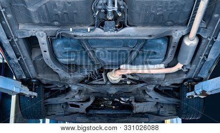 Car Suspension Maintenance Service Concept - Car On Lift Raises Vehicle In Maintenance Service