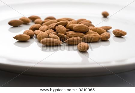 Shelled Almonds On White Plate Selective Focus