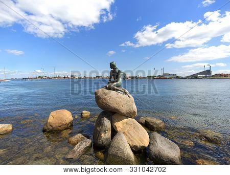 Copenhagen, Denmark - June 22, 2019: The Little Mermaid, Bronze Statue ,character From The Fairy Tal
