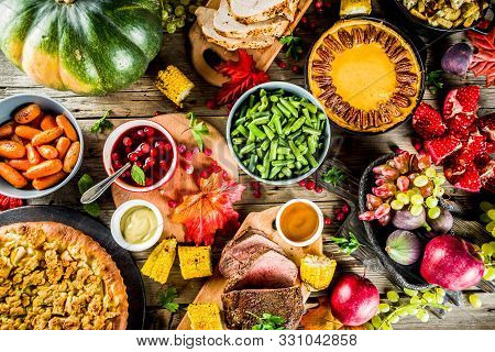 Thanksgiving Family Dinner Setting Concept. Traditional Thanksgiving Day Food  With Turkey, Green Be