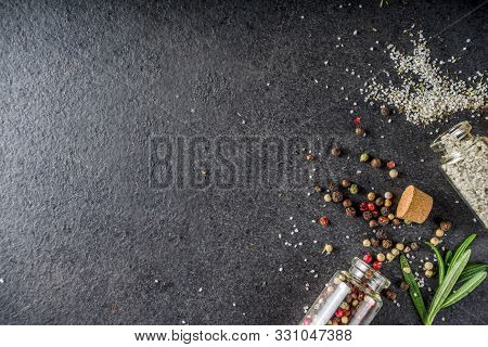 Cooking Food Background With Herbs, Olive Oil And Spices, Black Stone Concrete Background Above Copy