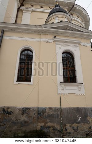 Closeup Of Dominican Church In Lviv. Old Building With Staircase. Entrance Stairs The Door Old. Door