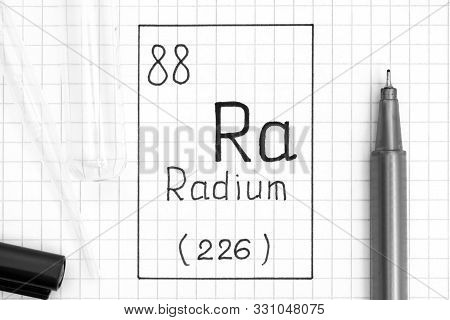 The Periodic Table Of Elements. Handwriting Chemical Element Radium Ra With Black Pen, Test Tube And