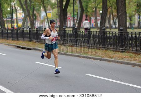 Dnipro, Ukraine - September 22, 2019: Male Winner (artem Kazban) Running On Dnipro City Street First