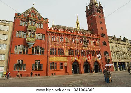 Basel, Switzerland - March 01, 2009: Famous Red Painted Town Hall Building Facade In Basel, Switzerl