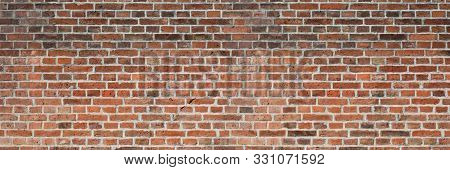 Brick Wall Of Red Color, Wide Panorama Of Old Wall. Grunge Brick.