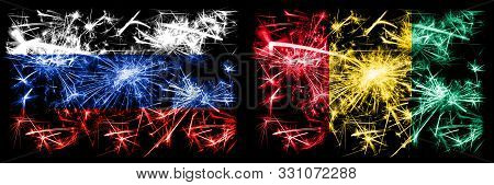 Russia, Russian Vs Guinea, Guinean New Year Celebration Sparkling Fireworks Flags Concept Background