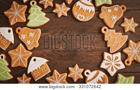Festive Christmas Gingerbread Cookies In The Shape Of A Star Lie On A Wooden Dark Brown Background.