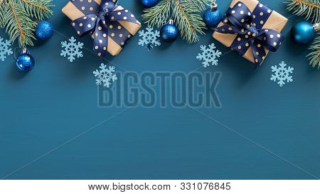 Elegant Christmas Composition. Flat Lay Gift Boxes With Blue Ribbon Bow, Fir Tree, Blue Balls And Sn