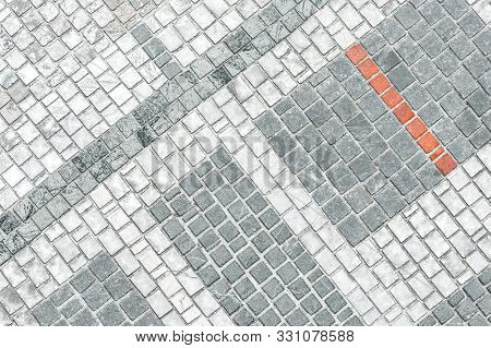 Background Of Cobblestones With One Strip Of Red Bricks