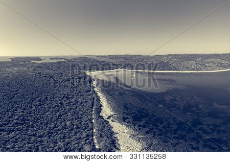 Spectacular Aerial Sea Landscape Of Sandy Beach And Crystal Clear Water.