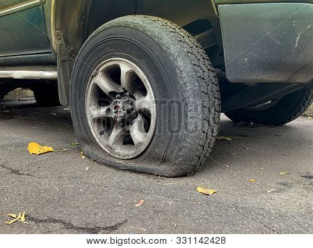 Flat Tire Of An Allroad Car, Car Breakage And Changing Wheels Concept.