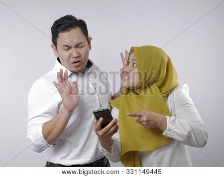 Muslim Couple Having Fight, Jealous Wife Finds Her Husband Cheating On Mobile Phone. Husband Deny Fo