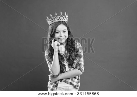 Source Of Pride. Proud Little Girl Wearing Crown Jewel With Pride On Red Background. Adorable Small