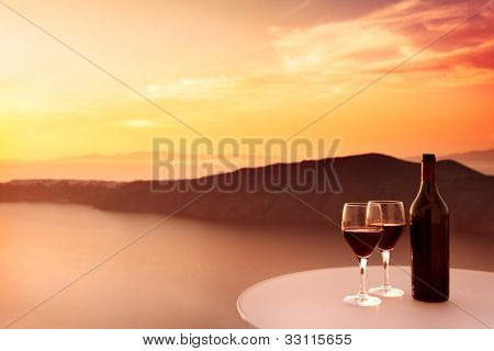 2 glasses of red wine and beautiful sunset