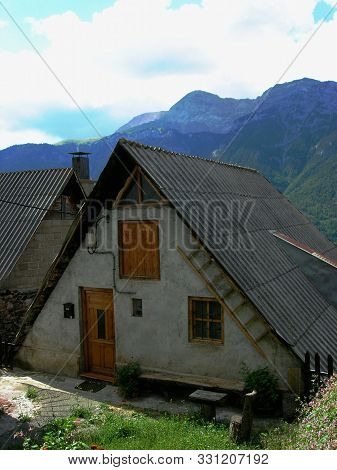 Beautiful Typical House Of The Aragonese Pyrenees, With Its Black Roof And Exaggerated Slope