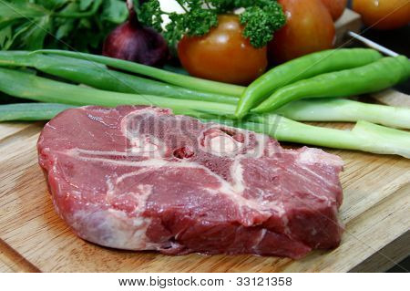 Raw beef steak meat with garnishing on board poster