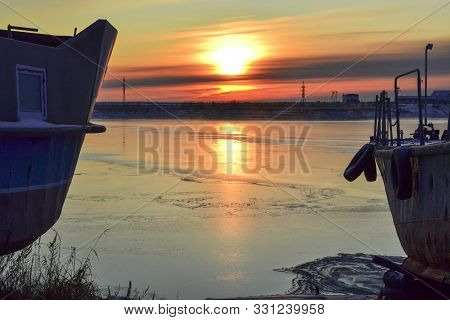 Old Boats On The Shore. The First Snow On The River. Morning Sunrise. Khanty-mansiysk.