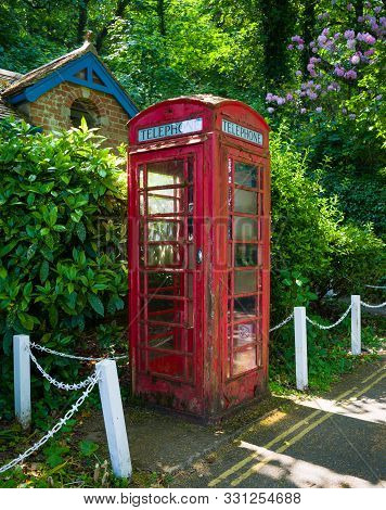 Old English Red Telephone Box, Booth In Village, Dartmouth, Devon, United Kingdom, May 23, 2018.