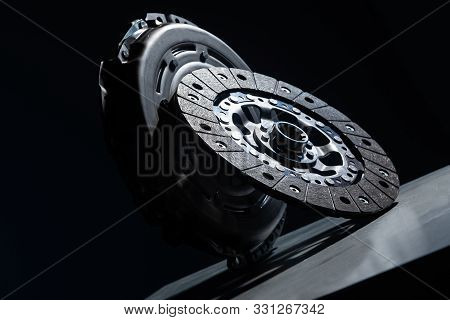Spare Part - Clutch Disk Against Black Background. Photo With Depth Of Field