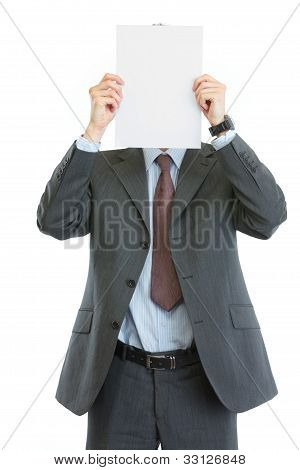 Modern Businessman Holding Blank Paper Sheet In Front Of Face