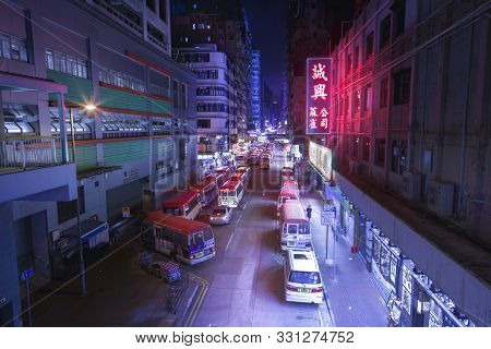 Hong Kong, China- July 14, 2019: Buses And Cars On The Main Street In Hong Kong. Hong Kong, China- J