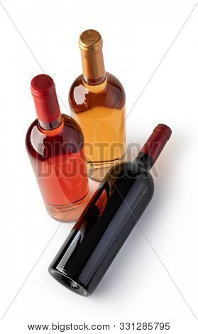 White, Rose, And Red Wine Bottles. Isolated On White Background