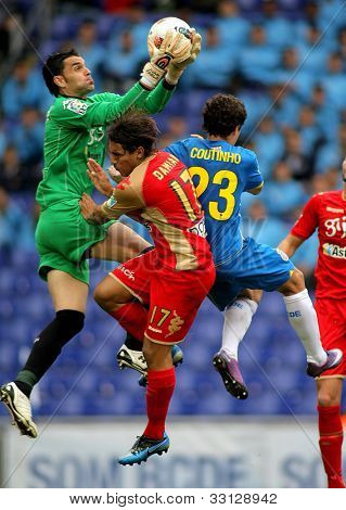 BARCELONA - 28, APRIL: Juan Pablo Colinas(L) of Gijon block the ball between Damian(C) and Coutinho(L) during a Spanish League match at the Estadi Cornella on April 28, 2012 in Barcelona, Spain