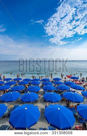 Monterosso, Italy - August 22, 2018: Beach Parasol On The Beach Of Monterosso Beach, Cinque Terre