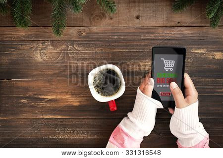 Hand Of Female Using Mobile Phone To Online Shopping. Christmas And New Year Holiday Online Shopping