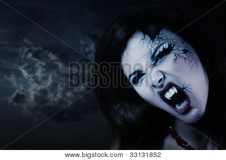 evil vampire woman beautiful halloween over night background