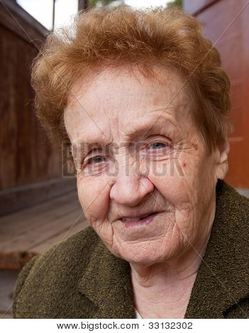 Closeup portrait of an senior woman 85 years old, looking at camera.