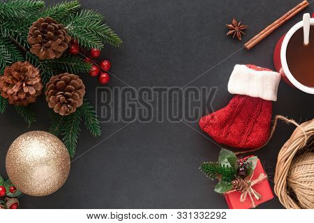 Holiday Christmas Black Granite Wallpaper. Christmas Card Background With Sock And Festive Decoratio
