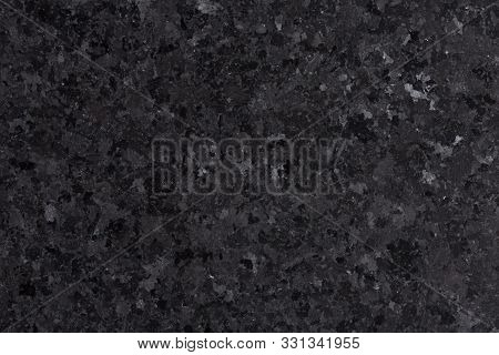 Black Natural Granite Texture For Design Close-up.