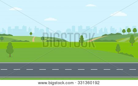 Straight Empty Road Through The Countryside On City Background. Green Hills, Blue Sky, Meadow. Summe