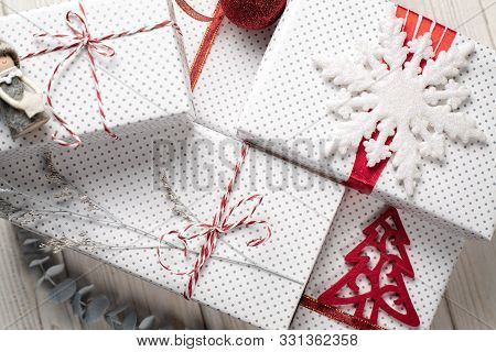 Christmas or New year ornaments in red  and white color on white background, top view. Holiday décor concept. Flat lay, vertical composition poster