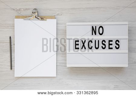 'no Excuses' Words On A Modern Board On A White Wooden Background, Top View. Overhead, From Above, F