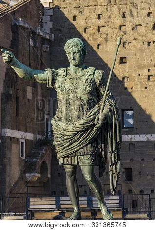 Caesar Octavian Augustus Statue In Front Of Ancient Trajan's Market In Rome, Italy