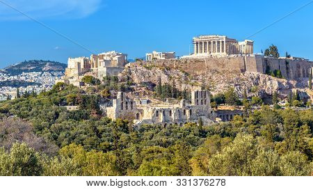 Acropolis Of Athens In Summer, Greece. View Of Famous Parthenon And Odeon Of Herodes. Urban Landscap