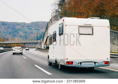 White Camper Rv In Road On Highway
