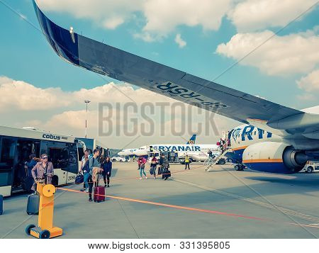 Krakow, Poland - March 10, 2019  Passengers Get Out Of The Airplane Ryanair And Sit On Buses At The