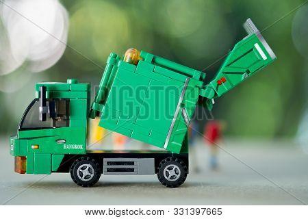 Miniature Green Plastic Garbage Truck. Children Toy. Garbage Truck Toy