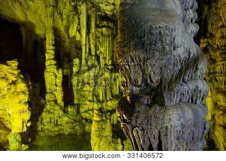 Cave Rock Formations Are Stalactites And Stalagmites In Colorful Light. The Miracle Of The Formation